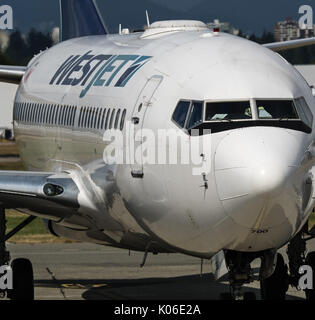 Richmond, British Columbia, Canada. 18th Aug, 2017. A WestJet Airlines Boeing 737-700 (C-GWSP) on the tarmac, South - Stock Photo