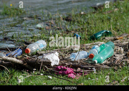 Plastic Contamination into Nature. Garbage and bottles floating on water. Environmental pollution in Georgia. Garbage - Stock Photo
