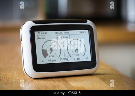 Domestic Energy Smart Meter on a Kitchen Worktop Displaying Carbon Emissions in Real Time - Stock Photo