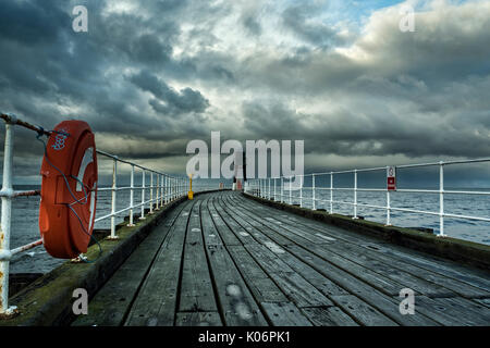 West Pier at Whitby late afternoon on a grey day, November, North Yorkshire - Stock Photo