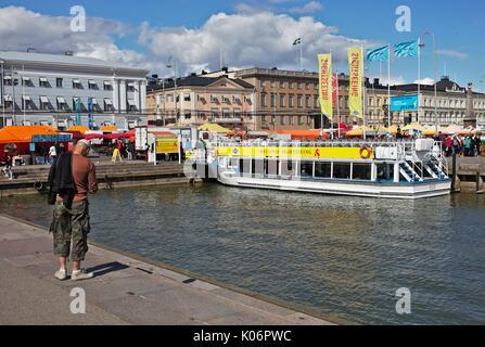 Man standing on quay in Helsinki, Finland - Stock Photo