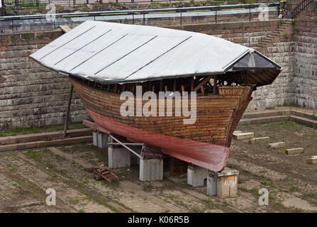 Old wodden ship hull in dry dock, Suomenlinna, Finland - Stock Photo