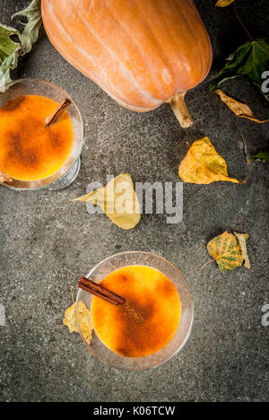 Fall and winter drinks. Thanksgiving and Halloween cocktails. Pumpkin pie margarita with cinnamon stick, on black - Stock Photo