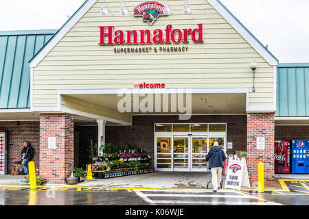 Camden, USA - June 9, 2017: Hannaford supermarket in Maine city with sign and people shopping - Stock Photo