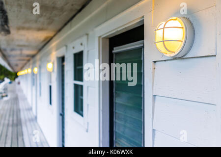 Row of hotel or motel doors outside with illuminated lights l&s in evening - Stock Photo & Cheap motel room doors Stock Photo Royalty Free Image: 89413833 ... pezcame.com