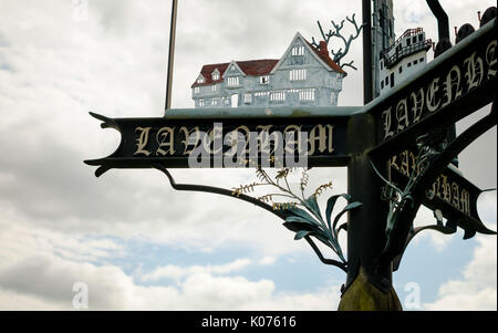 Ornate metal sign for Lavenham, Suffolk, UK, featuring the medieval houses for which the village is famous - Stock Photo