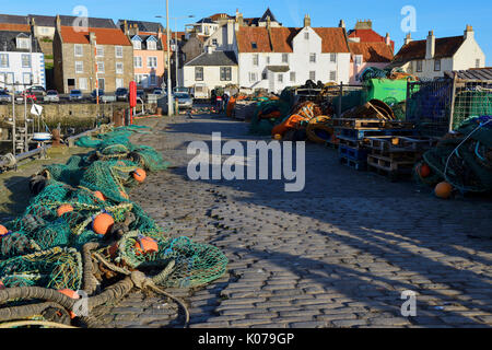 Fishing nets and lobster pots on quayside at Pittenweem harbour in East Neuk of Fife, Scotland, UK - Stock Photo