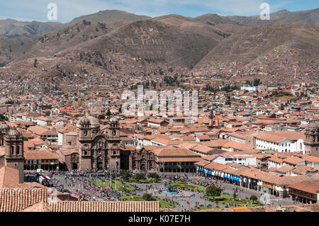 A view over Plaza de Armas, the historic centre of Cusco, and surrounding mountains covered in inscriptions, Peru. - Stock Photo