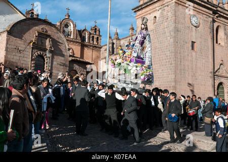 Parishioners carry a large statue of Saint Joseph on a pedestal from Cusco Cathedral during celebrations of Corpus - Stock Photo