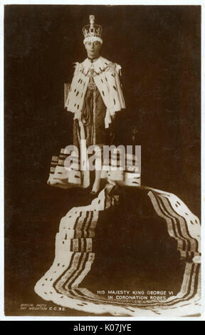 King George VI in his coronation robes - May 12th 1937. The reverse of the postcard records that the photographic - Stock Photo