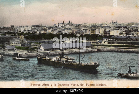 Harbour scene at the north entrance to the docks, with steamship and tugs, Puerto Madero, Buenos Aires, Argentina, - Stock Photo