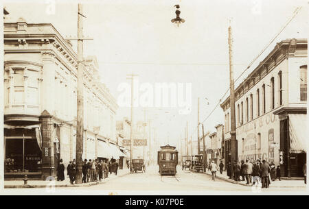 American street scene with tram and people -- including a drug store Sawyer & Filley, Doctor Redpath, The Pfister - Stock Photo