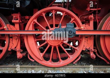 Red wheel, driving wheel and propulsion rod, historical steam engine 50245, Triberg railway station, Triberg, Black - Stock Photo
