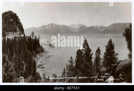 View above Lake Tahoe from Cave Rock, California, USA, with a steamer on the water, and Mount Tallac in the distance - Stock Photo
