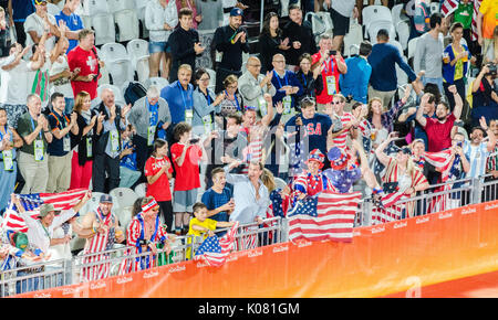 American fans cheer in a volleyball event at the 2016 Olympic Games in Rio de Janeiro, Brazil - Stock Photo
