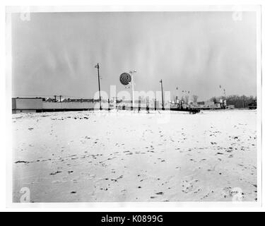 View of the large, tall GULF Gas Station sign, the station has not been built yet and the ground is not concrete, - Stock Photo