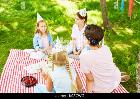 Birthday party on lawn - Stock Photo