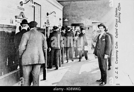 Passengers queueing for twopenny tickets at Oxford Circus tube station booking office, Central London.      Date: - Stock Photo
