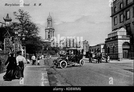 Marylebone Road (looking east), London, with park gates on the left and Holy Trinity Church in the middle distance. - Stock Photo