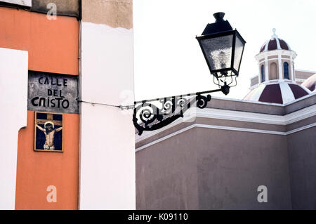 A religious artwork of ceramic tiles shows Jesus Christ on the cross and marks Calle del Cristo (Street of the Crucifix) - Stock Photo