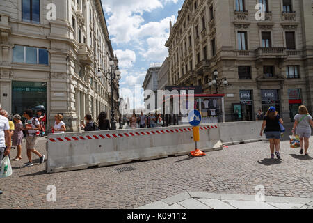 Jersey barriers in Piazza Cordusio, Milan, Italy - Stock Photo