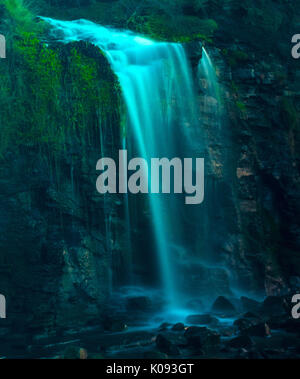 Kimmeridge Bay Waterfall onto Beach - Stock Photo