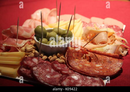 Chopped table of cold cuts with beer - Stock Photo