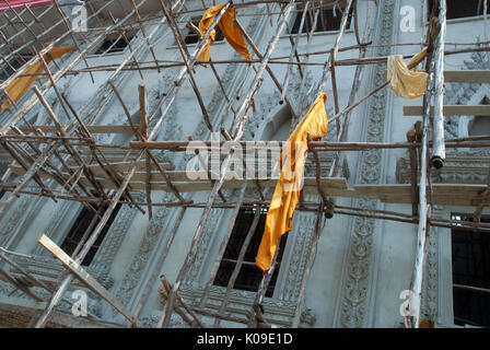 Repair works to the temple building, Wat Thip Santiwan, Udon Thani, Thailand. - Stock Photo