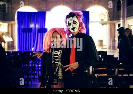 Skeleton Costume Two College Students Are Posing For A Picture The Girl Is Wearing Pink Wig