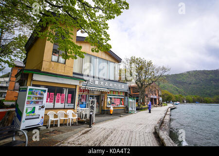 Aomori, Japan - May 16, 2017. Souvenir shops at Lake Towada in Aomori, Japan. Lake Towada is the largest caldera - Stock Photo