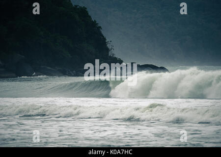 A wave breaking in Castelhanos Beach, Ilhabela, Brazil - Stock Photo
