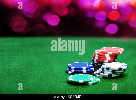Casino background and chips, poker chips on a green table. Poker game concept - Stock Photo