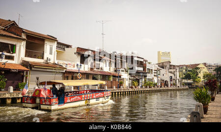 Melaka, Malaysia - Feb 9, 2014. Tourist boat running on the canal in Melaka, Malaysia. Melaka (Malacca) is one of - Stock Photo