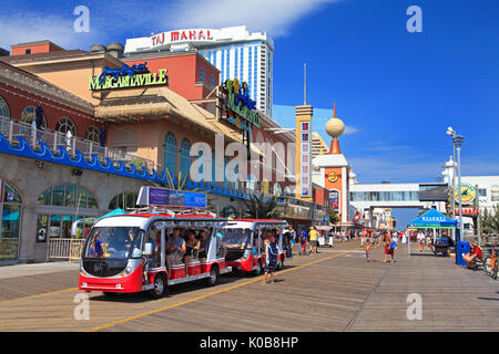 ATLANTIC CITY, NEW JERSEY - AUGUST 19, 2017: Tourists traveling on the boardwalk in Atlantic City. Established in - Stock Photo
