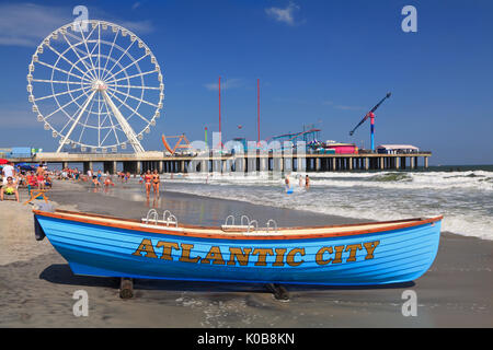 ATLANTIC CITY, NEW JERSEY - AUGUST 19, 2017: Boat lifeguard, beach and steel Pier in Atlantic City. Established - Stock Photo