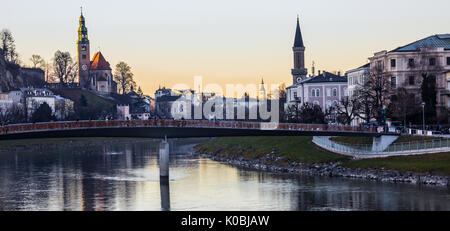 Romantic Twilight view Day Scene of Salzburg Old Town with Makartsteg Bridge and Salzach River as foreground, Salzburg - Stock Photo