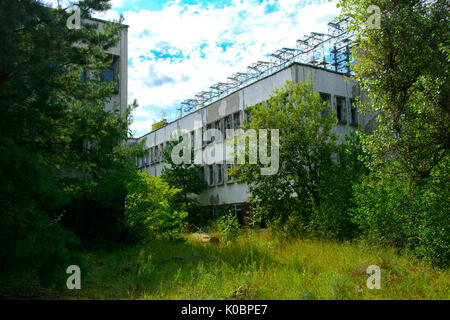 Destroyed buildings in the exclusion zone. Dead military unit. Consequences of the Chernobyl nuclear disaster, August - Stock Photo