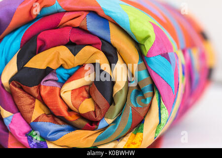 sewing, patchwork and fashion concept. An old coverlet with an intricate pattern and a palette of colors of various - Stock Photo
