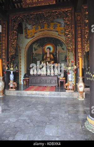 View of main shrine with statue of Shakyamuni Buddha in lotus position. Linh Ung Non Nuoc Pagoda. Da Nang. VIETNAM - Stock Photo