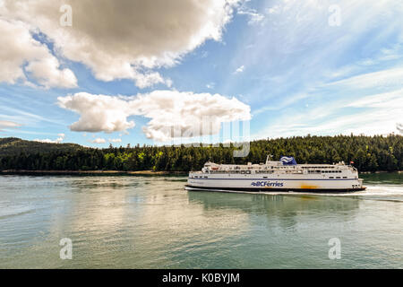 VANCOUVER, BC, CANADA - MAY 13, 2017: BC Ferries carrying cars, trucks, and passengers year round between Vancouver - Stock Photo