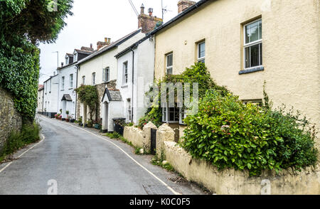 No people or traffic in a quiet street of light colour rendered, terraced cottages, inland from the coast at Woolacombe. - Stock Photo