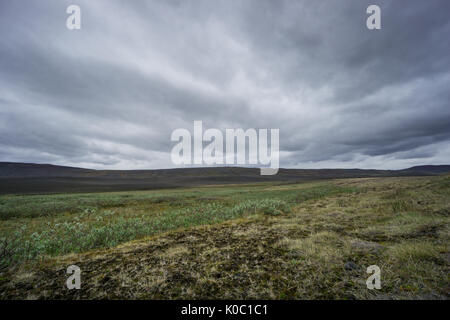 Iceland - Dark atmosphere at lonely flat landscape of volcanic origin - Stock Photo