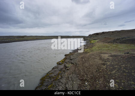 Iceland - Fast natural river through volcanic magic landscape - Stock Photo