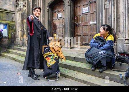 EDINBURGH, UNITED KINGDOM - AUGUST 15, 2017 - An asian boy disguised in Harry Potter along the Royal Mile of Edinburgh - Stock Photo