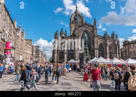 EDINBURGH, UNITED KINGDOM - AUGUST 15, 2017 - A boy advertises a theatrical performance along the Royal Mile of - Stock Photo