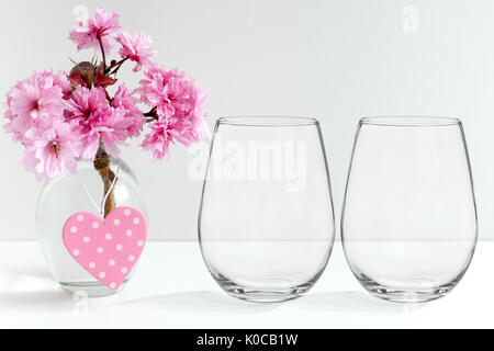 Floral mock-up of two stemless wine glasses, perfect for businesses who sell decals, vinyl stickers, just overlay - Stock Photo