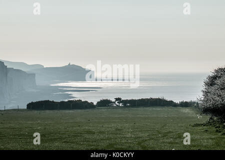 Belle Tout Lighthouse from Seaford Head on April morning. - Stock Photo