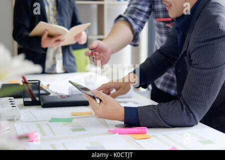 business consulting a three business man on office with meeting to plan of business. - Stock Photo
