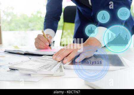 Business man calculate accountant or banker making calculations. Savings, finances and economy concept. - Stock Photo