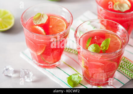 watermelon lemonade with lime and mint, summer refreshing drink - Stock Photo